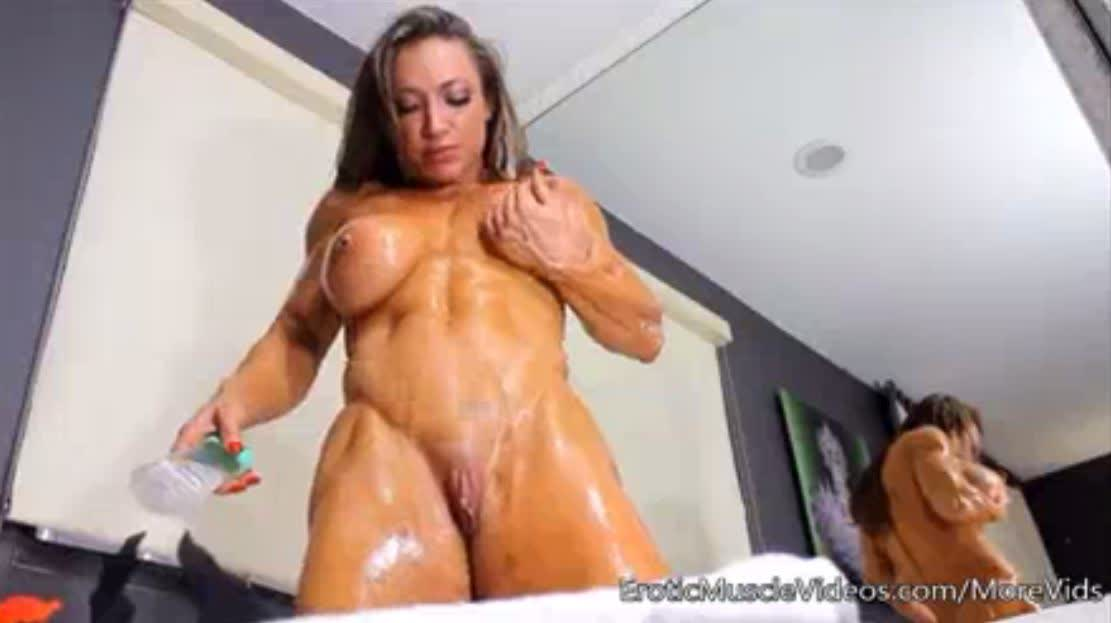 Lubricating the sexual muscles of a beautiful bodybuilder